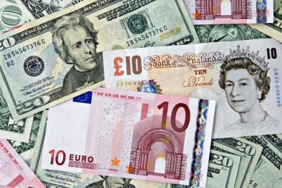 British pound, euro and dollar--621x414